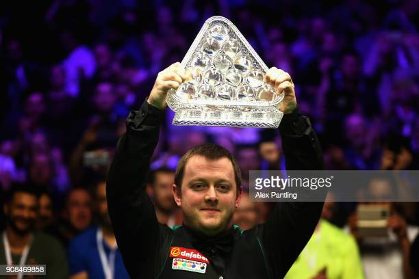 Mark Allen lifts the trophy as he celebrates victory following The Dafabet Master Final between Kyren Wilson and Mark Allen at Alexandra Palace on...