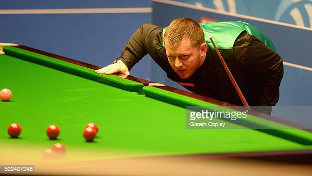 Mark Allen lines up a shot against Mitchell Mann during their first round match of the World Snooker Championship at Crucible Theatre on April 19...