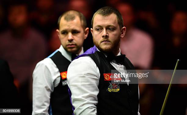 Mark Allen of Northern Ireland and Barry Hawkins of England look on during their quarter final match on day five of The Dafabet Masters at Alexandra...