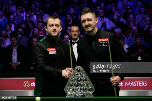 Mark Allen of Northern Ireland and Kyren Wilson of England pose before the final match on day eight of The Dafabet Masters at Alexandra Palace on...