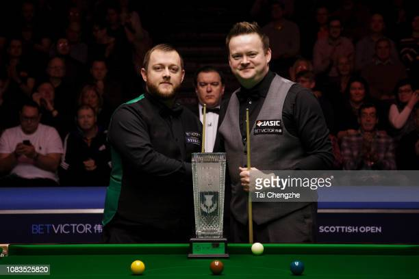 Mark Allen of Northern Ireland and Shaun Murphy of England shake hands before the final match on day 7 of 2018 BetVictor Scottish Open at Emirates...