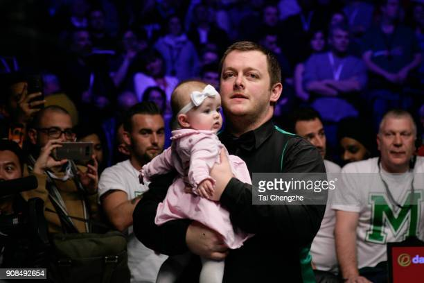 Mark Allen of Northern Ireland celebrates with his daughter after winning the final match against Kyren Wilson of England on day eight of The Dafabet...