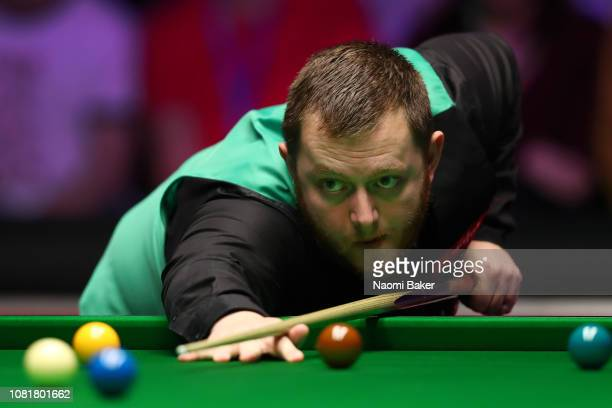 Mark Allen of Northern Ireland in action during his first round match against Luca Brecel of Belgium during day one of The Dafabet Masters at...