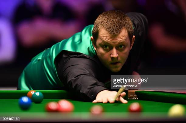 Mark Allen of Northern Ireland in action during his match against Ronnie O'Sullivan of England during The Dafabet Masters on Day Five at Alexandra...