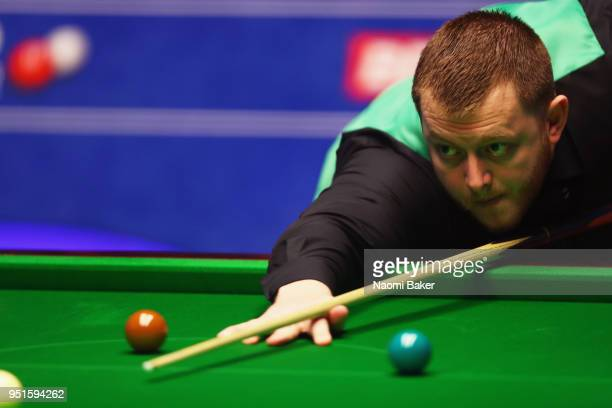 Mark Allen of Northern Ireland in action during his second round match against Joe Perry of England during day six of the World Snooker Championship...