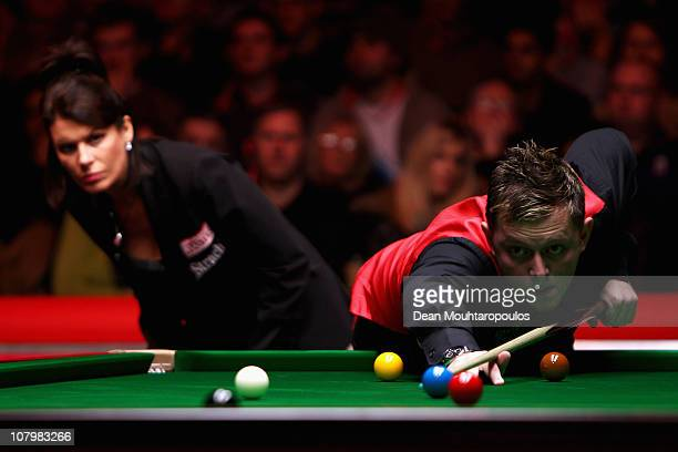 Mark Allen of Northern Ireland in action watched by referee Michaela Tabb against Ronnie O'Sullivan of England in Round One of The Ladbrokesmobile...