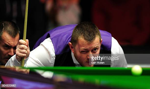 Mark Allen of Northern Ireland lines up a shot against Shaun Murphy of England during Day One of the Dafabet Masters at Alexandra Palace on January...