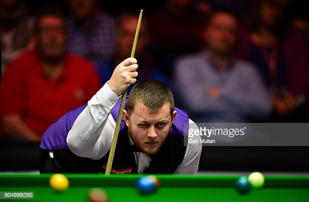 Mark Allen of Northern Ireland lines up a shot during his quarter final match against Barry Hawkins of England during day five of The Dafabet Masters...