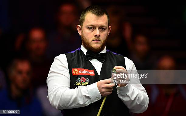 Mark Allen of Northern Ireland looks on during his quarter final match against Barry Hawkins of England during day five of The Dafabet Masters at...