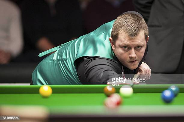 Mark Allen of Northern Ireland plays a shot during his first round match against John Higgins of Scotland on day two of the Dafabet Masters at...