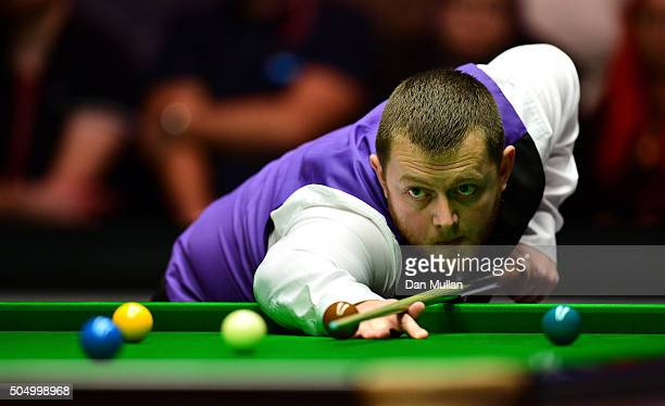Mark Allen of Northern Ireland plays a shot during his quarter final match against Barry Hawkins of England during day five of The Dafabet Masters at...