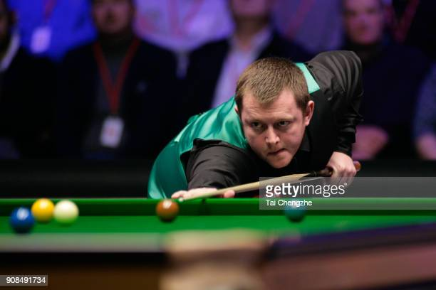 Mark Allen of Northern Ireland plays a shot during the final match against Kyren Wilson of England on day eight of The Dafabet Masters at Alexandra...