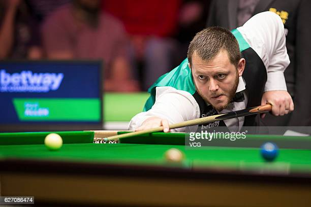 Mark Allen of Northern Ireland plays a shot during the fourth round match against John Higgins of Scotland on day 10 of Betway UK Championship 2016...