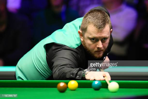 Mark Allen of Northern Ireland plays a shot during the quarterfinal match against Nigel Bond of England on day eleven of 2019 Betway UK Championship...