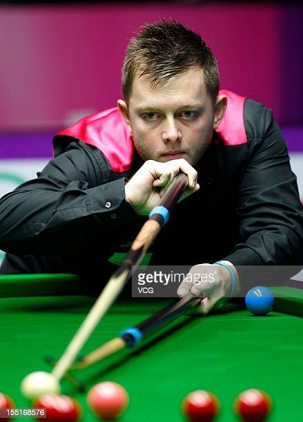 Mark Allen of Northern Ireland plays a shot in the quarter final match against Judd Trump of England on day five of the 2012 World Snooker...