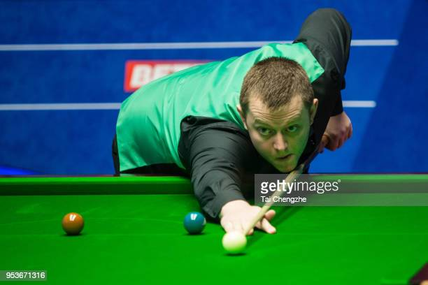 Mark Allen of Northern Ireland plays a shot in the quarterfinal match against Kyren Wilson of England during day eleven of the World Snooker...