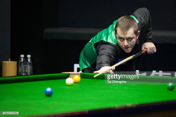 Mark Allen of Northern Ireland plays a shot in the second round match against Yan Bingtao of China during day three of the 2018 China Open at Olympic...