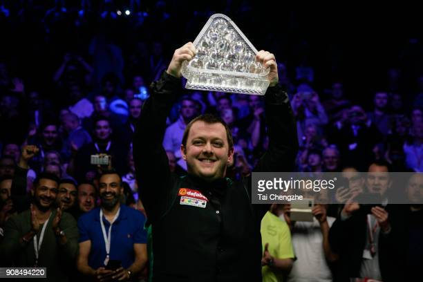 Mark Allen of Northern Ireland poses with his trophy after winning the final match against Kyren Wilson of England on day eight of The Dafabet...
