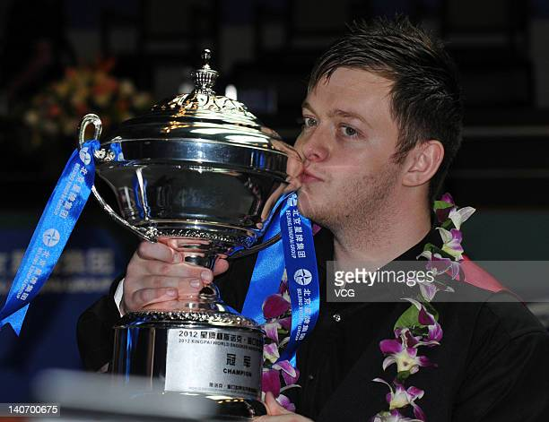 Mark Allen of Northern Ireland poses with the trophy after winning the final against Stephen Lee of England on day 7 of Haikou World Open 2012 at...