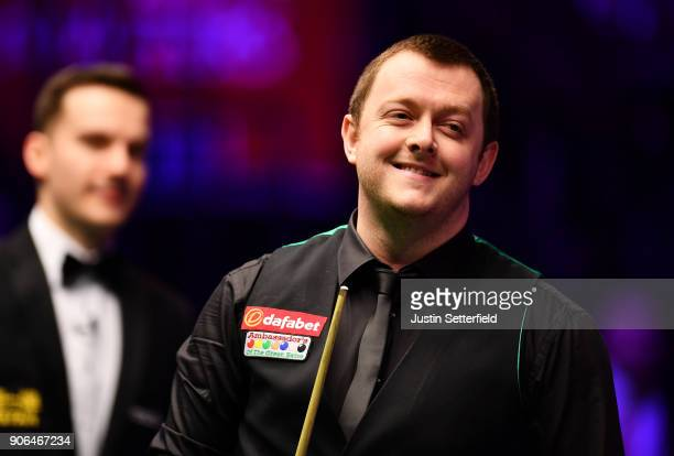 Mark Allen of Northern Ireland reacts during his match against Ronnie O'Sullivan of England during The Dafabet Masters on Day Five at Alexandra...