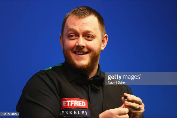Mark Allen of Northern Ireland reacts during his second round match against Joe Perry of England during day six of the World Snooker Championship at...