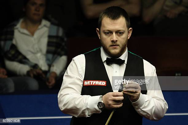 Mark Allen of Northern Ireland reacts in the second round match against Kyren Wilson of England on day nine of Betfred World Championship 2016 at The...