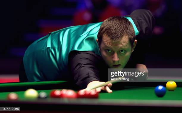 Mark Allen plays a shot during the SemiFinal match between Mark Allen and John Higgins on Day Seven of The Dafabet Masters at Alexandra Palace on...