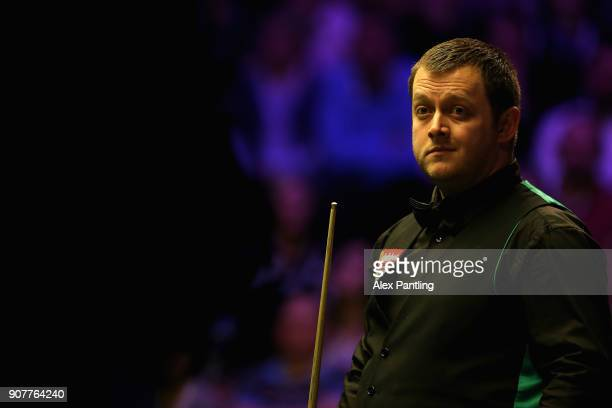 Mark Allen reacts during the SemiFinal match between Mark Allen and John Higgins on Day Seven of The Dafabet Masters at Alexandra Palace on January...