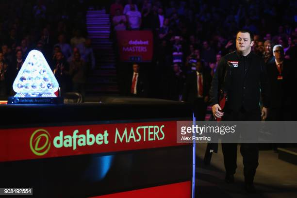 Mark Allen walks past the trophy during The Dafabet Master Final between Kyren Wilson and Mark Allen at Alexandra Palace on January 21 2018 in London...