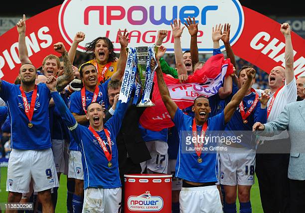 Mark Allott and Dwayne Mattis of Chesterfield celebrate with the trophy after being crowned Champions during the npower League Two match between...