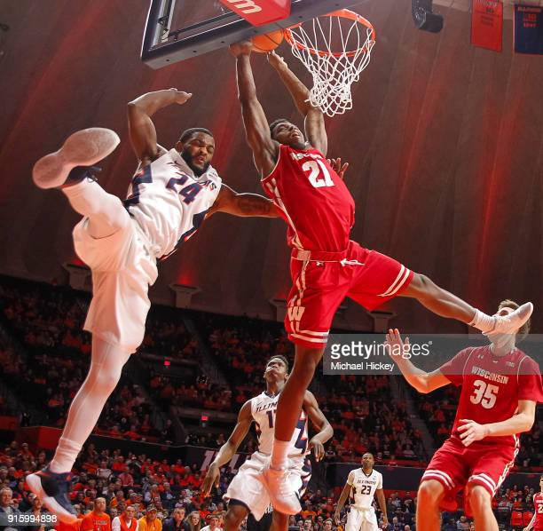 Mark Alstork of the Illinois Fighting Illini fouls Khalil Iverson of the Wisconsin Badgers in the act of shooting during the game at State Farm...