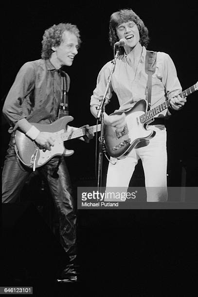 Mark and and David Knopfler performing with British rock group Dire Straits New York September 1979