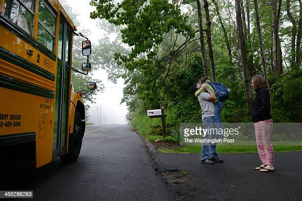 Mark and Jackie Barden hug their daughter Natalie, 11 before she goes to school in Newtown, CT on May 23, 2013. Daniel Barden, their son, was among...