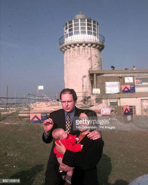 Mark and Louise Roberts baby Quinn the new owners of the Belle Tout lighthouse at Beachy Head East Sussex which is due to be moved away from a...