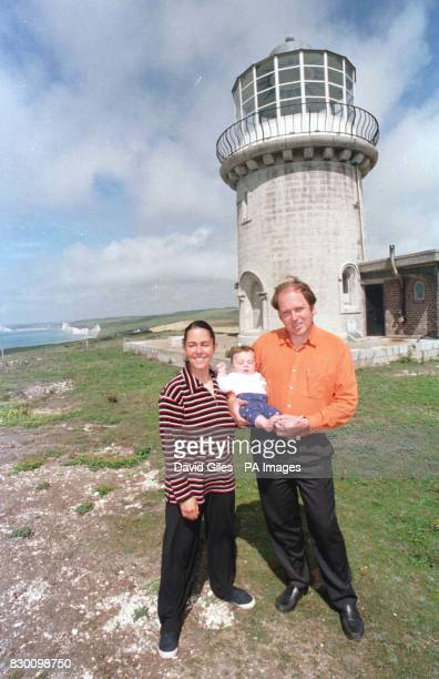 Mark and Louise Roberts with their daughter Haven outside their home the Belle Tout lighthouse at Beachy Head near Eastbourne Sussex which stands...