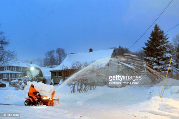 Mark Anderberg of Saco uses his tractor with a snow blower to clear a neighbors driveway on Mechanic St in Saco at 700 Tuesday March 13 2018