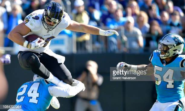 Mark Andrews of the Baltimore Ravens hurdles James Bradberry of the Carolina Panthers during their game at Bank of America Stadium on October 28 2018...