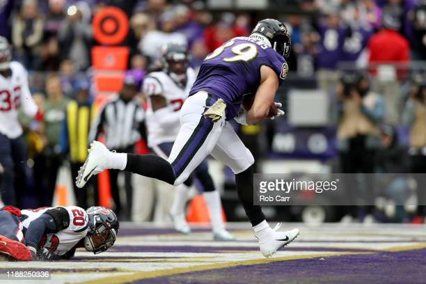 Mark Andrews of the Baltimore Ravens scores an 18 yard touchdown against the Houston Texans during the second quarter in the game at MT Bank Stadium...