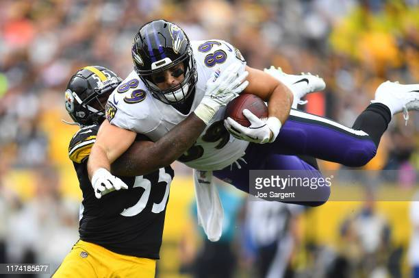 Mark Andrews of the Baltimore Ravens tries to hurdle Devin Bush of the Pittsburgh Steelers during the first quarter at Heinz Field on October 6, 2019...