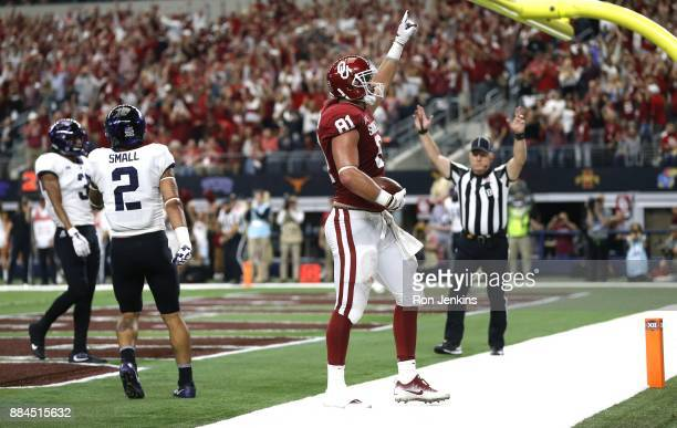 Mark Andrews of the Oklahoma Sooners celebrates a touchdown pass as Niko Small and Markell Simmons of the TCU Horned Frogs look on in the first half...