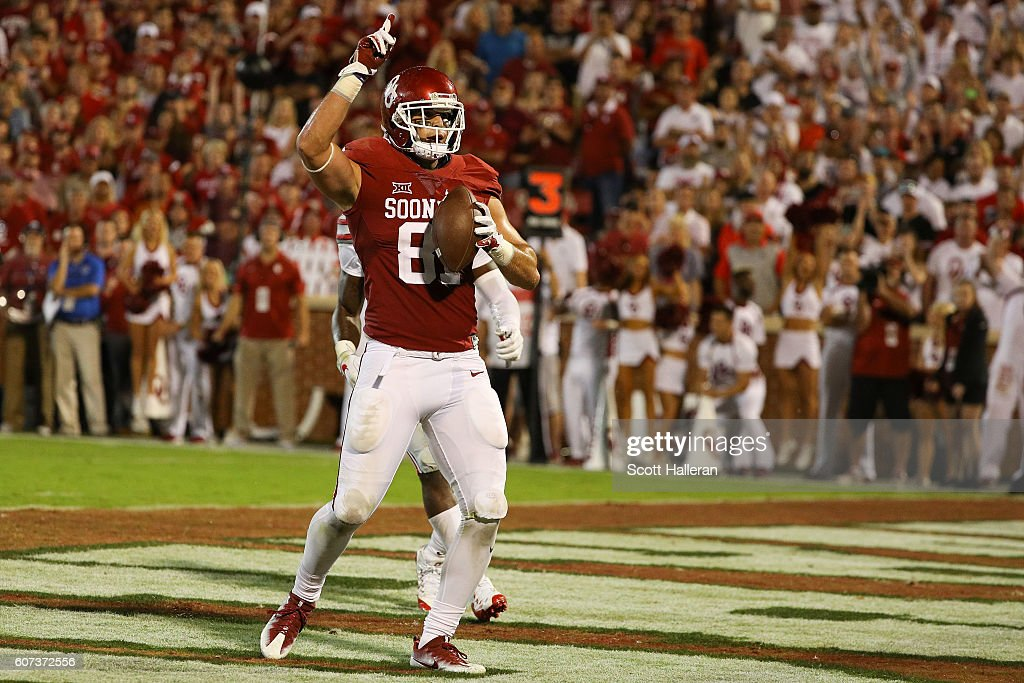 Mark Andrews #81 of the Oklahoma Sooners celebrates after catching a touchdown pass from Baker Mayfield #6 against the Ohio State Buckeyes at Gaylord Family Oklahoma Memorial Stadium on September 17, 2016 in Norman, Oklahoma.