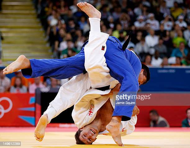 Mark Anthony of Australia competes with Varlam Liparteliani of Georgia during the Men's 90 kg Judo on Day 5 of the London 2012 Olympic Games at ExCeL...