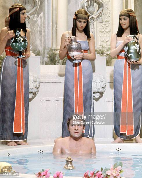 Mark Anthony played by Welsh actor Richard Burton is attended by Egyptian handmaidens as he bathes in 'Cleopatra' directed by Joseph L Mankiewicz 1963
