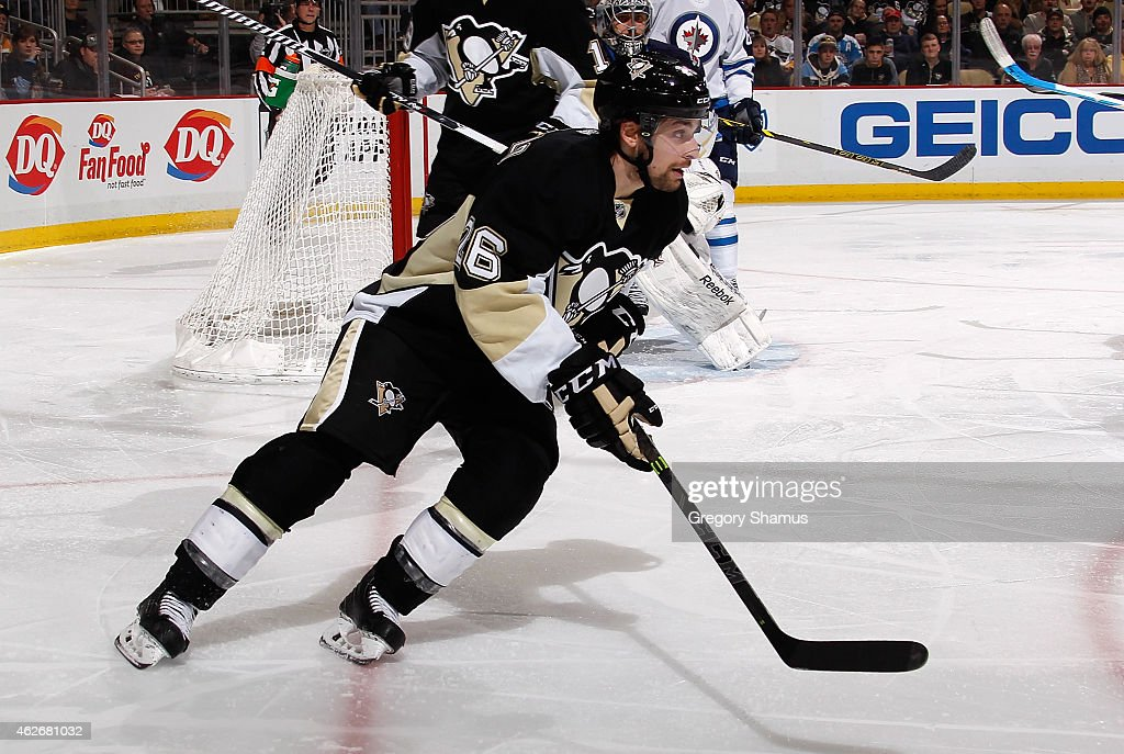 Mark Arcobello #26 of the Pittsburgh Penguins skates against the Winnipeg Jets at Consol Energy Center on January 27, 2015 in Pittsburgh, Pennsylvania.