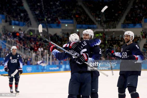 Mark Arcobello of the United States celebrates with his teammates after scoring a goal on Jan Laco of Slovakia in the second period during the Men's...