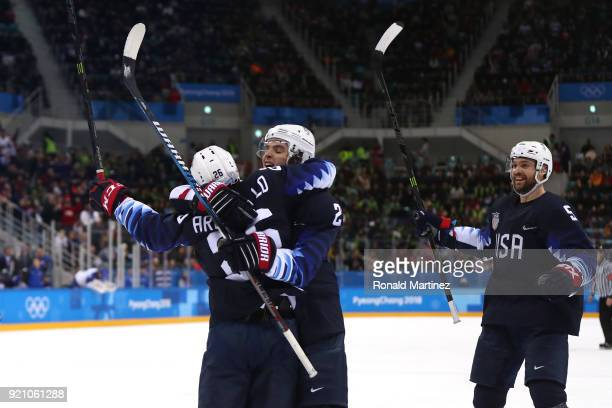 Mark Arcobello of the United States celebrates with his teammates after scoring against Jan Laco of Slovakia in the second period during the Men's...