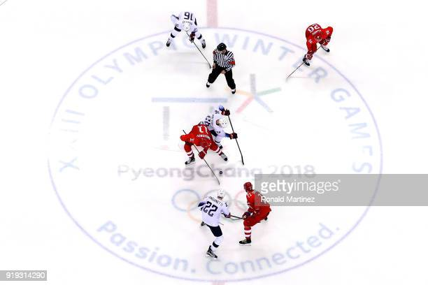 Mark Arcobello of the United States faces off against Sergei Andronov of Olympic Athlete from Russia during the Ice Hockey Women's Playoffs...