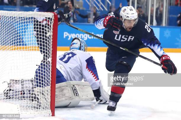 Mark Arcobello of the United States scores a goal on Jan Laco of Slovakia in the second period during the Men's Playoffs Qualifications game on day...