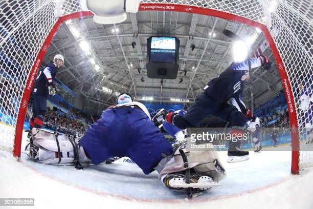 Mark Arcobello of the United States scores a goal on Jan Laco of Slovakia in the second period during the Men's Play-offs Qualifications game on day...