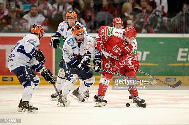 Mark Ardelan of Iserlohn challenges Rok Ticar of Cologne during the DEL match between Koelner Haie and Iserlohn Roosters at Lanxess Arena on January...